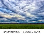 sky with rain clouds over the... | Shutterstock . vector #1305124645