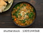 french lentil and spinach soup | Shutterstock . vector #1305144568
