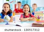 portrait of two diligent girls... | Shutterstock . vector #130517312