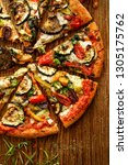 vegetarian pizza with addition... | Shutterstock . vector #1305175762