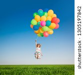 happy child playing with bright ... | Shutterstock . vector #1305197842
