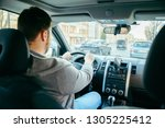 young adult man driving car by... | Shutterstock . vector #1305225412