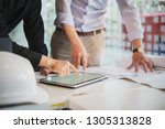 business partners use tablet...   Shutterstock . vector #1305313828