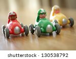 Stock photo racing cars on a table top racetrack concept for competition or childhood 130538792