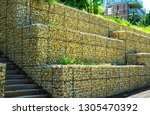 gabion retaining wall   metal... | Shutterstock . vector #1305470392