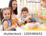 little children engaged in... | Shutterstock . vector #1305480652