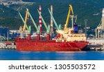 a bulk carrier in a port. bulk... | Shutterstock . vector #1305503572
