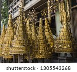 brass golden umbrellas for sale ... | Shutterstock . vector #1305543268