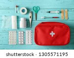 first aid kit on color wooden... | Shutterstock . vector #1305571195