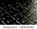 high angle view of black jigsaw ...   Shutterstock . vector #1305632962