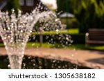 unfocused fountain near the old ... | Shutterstock . vector #1305638182