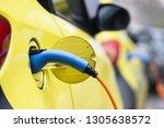 electric car recharging its... | Shutterstock . vector #1305638572