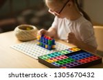 girl with down syndrome builds... | Shutterstock . vector #1305670432