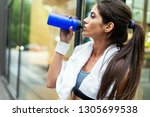 young sporty girl making a... | Shutterstock . vector #1305699538