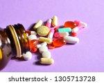 pills and glass jar with pills... | Shutterstock . vector #1305713728