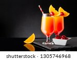 two cold tequila sunrise... | Shutterstock . vector #1305746968