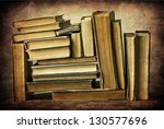 vintage old books on wooden... | Shutterstock . vector #130577696
