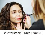 beautiful model girl applying...   Shutterstock . vector #1305870088