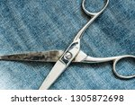 metal scissors laying on the... | Shutterstock . vector #1305872698