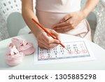 pregnant woman with calendar...   Shutterstock . vector #1305885298