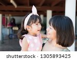 beautiful asian mother and cute ... | Shutterstock . vector #1305893425