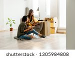 happy lesbian couple renovating ... | Shutterstock . vector #1305984808