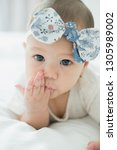 blue and white headband on the... | Shutterstock . vector #1305989002