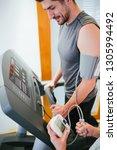 man on treadmill running.... | Shutterstock . vector #1305994492
