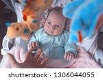 little baby in the swing.... | Shutterstock . vector #1306044055