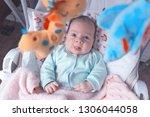 little baby in the swing.... | Shutterstock . vector #1306044058