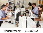 team working at desks in busy... | Shutterstock . vector #130609865