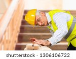 young man hands with tools | Shutterstock . vector #1306106722