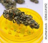grind marijuana buds for... | Shutterstock . vector #1306114192