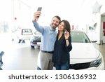 hispanic couple photographing... | Shutterstock . vector #1306136932