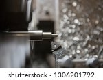 part machining with lathe  | Shutterstock . vector #1306201792