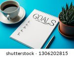 notepad with goals list  cup of ... | Shutterstock . vector #1306202815