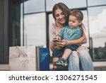 mother sitting with son and... | Shutterstock . vector #1306271545