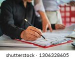 businessman writing note with... | Shutterstock . vector #1306328605