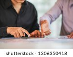 business partners use tablet... | Shutterstock . vector #1306350418