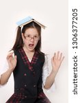 serious schoolgirl in glasses... | Shutterstock . vector #1306377205