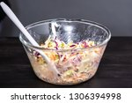 making homemade coleslaw in a... | Shutterstock . vector #1306394998