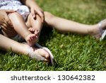 feet of two children on the... | Shutterstock . vector #130642382