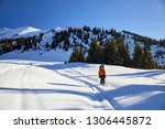 man skiing on fresh powder snow ... | Shutterstock . vector #1306445872