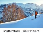 man skiing on fresh powder snow ... | Shutterstock . vector #1306445875