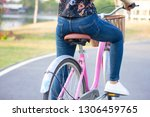 woman cycling on street outdoor   Shutterstock . vector #1306459765