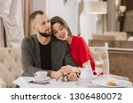 young and happy couple talking... | Shutterstock . vector #1306480072