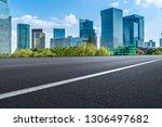highway road and skyline of... | Shutterstock . vector #1306497682