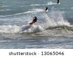 Three Kitesurfers Enjoying The...