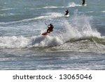 Three Kitesurfers Enjoying The...