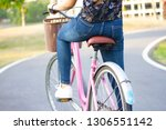 asian lady cycling on street in ...   Shutterstock . vector #1306551142